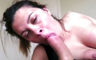 Raunchy brunette with huge boobs and big ass sucks a huge ramrod