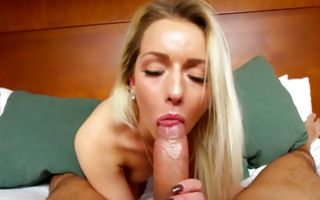 Sexy light-haired girlfriend making deep blowjob on bed