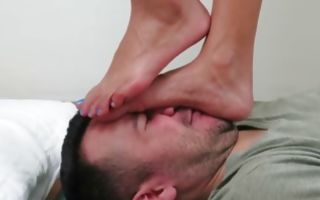 Horny chick walks all over his face making his dick hard