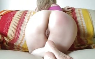 Perky babe with giant ass bends over exposing her shaved vagina