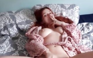 Ginger babe fingers her pussy hole and smokes