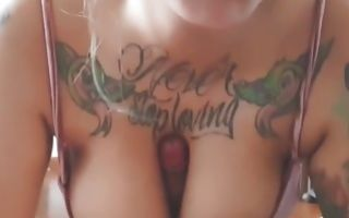 Nasty bitch with sexy tattoos blowing his massive fuck stick deep throat