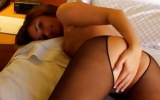Hot brunette on the bed fingering pussy hole