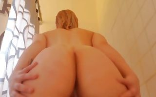 Hot babe with small boobs grabs her ass and exposes tits