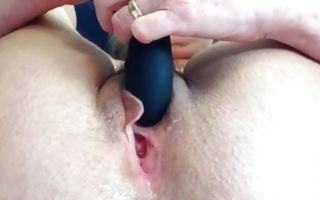 Hot babe masturbating with a huge dildo