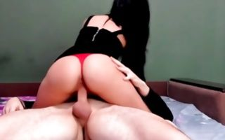 Hot babe wearing perky strings while riding a dick