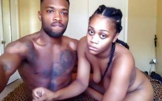 Black-skinned couple having sex on webcam