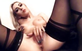 Pretty blonde lesbian girlfriends finger clits and strapon each other