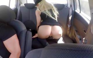 Cute blonde girlfriend poses fingering cunt in a taxi car