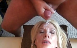 Raunchy blonde milf enjoys bukkake getting cum all over her face