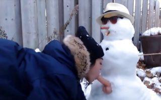 Naughty brunette girlfriend sucks a dildo of a snowman