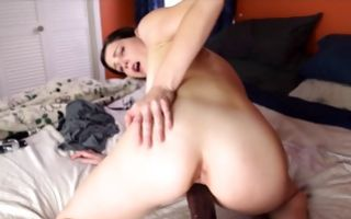Raunchy brunette in glasses gets dildos in holes in amateur solo