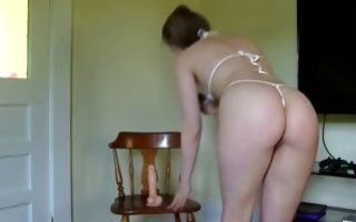 Nasty amateur bitch with round butt riding on sex toy